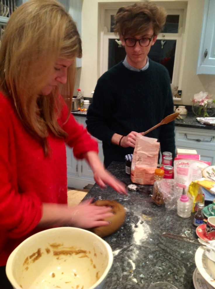 Izzy tends to the gingerbread whilst Charlie Terrorises her with a Wooden Spoon