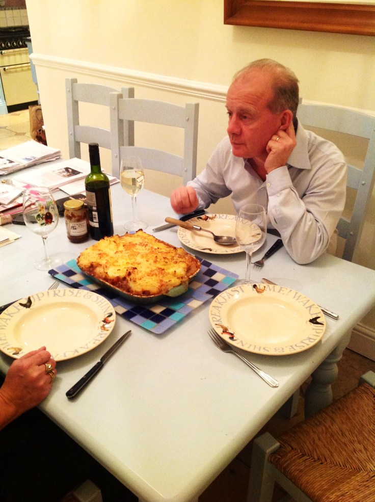 Dad Waiting in Anticipation for the Bubbling Shepherd's Pie