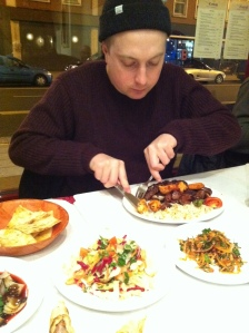 Adam Ploughing Through his Mixed Kebab